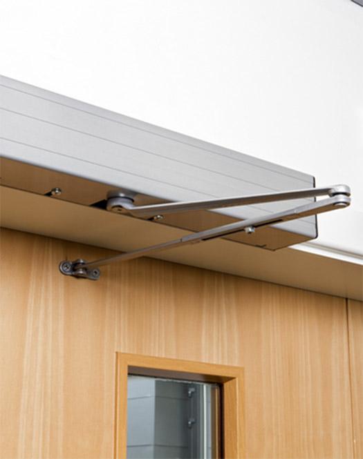 door opening mechanism above wooden door