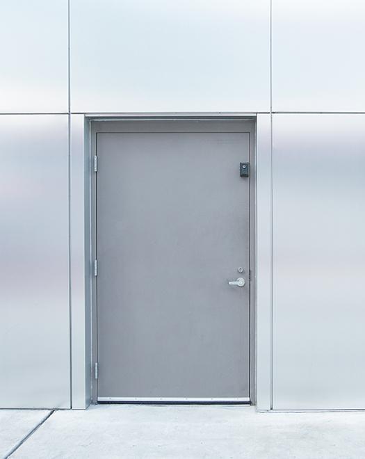 metal door in a modern wall with metal panels Commercial steel doors,Commercial steel door with frame, Commercial steel door frame,Commercial metal doors